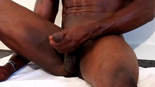 Buff ebony hunk loves stroking his wang