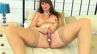 Scottish milf Toni Lace stuffs her fanny full in knickers