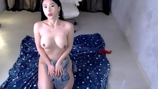 Busty Korean plays with dildo